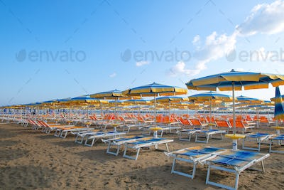 Umbrellas and sun loungers on the beach in the Adriatic. Romagna