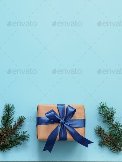 Gift box in craft paper and satin ribbon