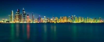 Amazing night skyline panorama of Dubai Marina skyscrapers. Dubai Marina. United Arab Emirates.