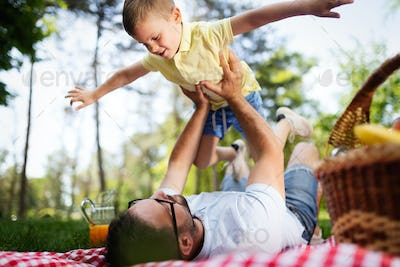Happy father and his son spending time together and playing, smiling outdoor