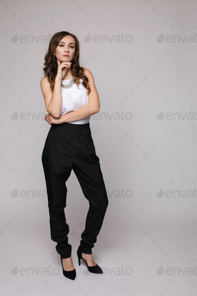 Successful female in smart outfit and glasses posing