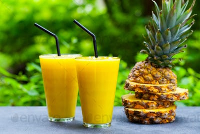 Pineapple with Tropical Fruit Juice, Smoothie on Outdoor Background.