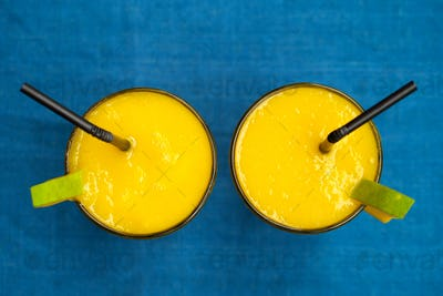 Fresh Mango Juice, Smoothie on Blue Background. Copy Space. Top View.