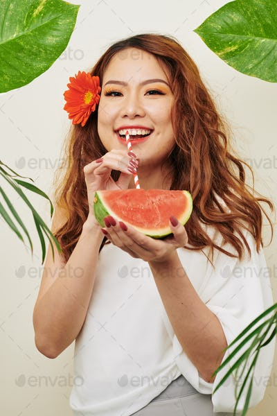 Asian woman with watermelon