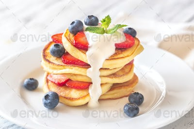 Portion of ricotta fritters with fresh berries