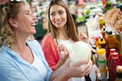 Women shopping fresh eggs at local farmer market