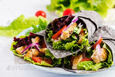 Tortilla with added ink cuttlefish wraps with chicken and vegetables
