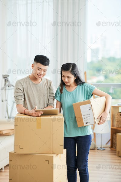 Couple working in delivery service