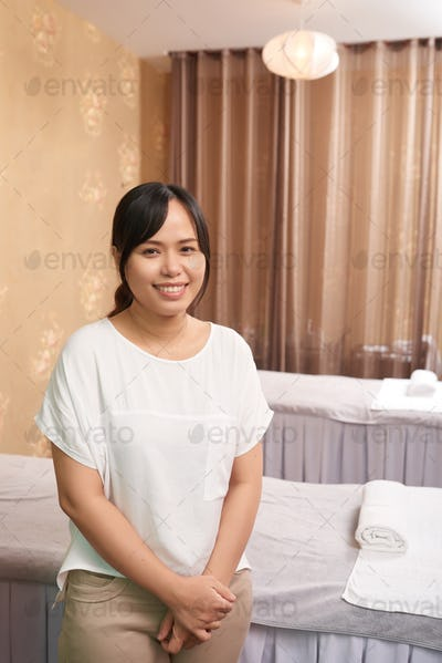 Massage therapist working in spa salon