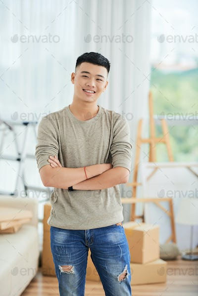 Asian man at home