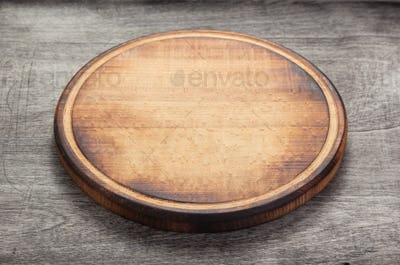 pizza cutting board at rustic wooden table
