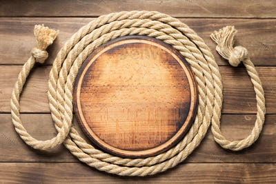 sign board and ship rope at wooden background