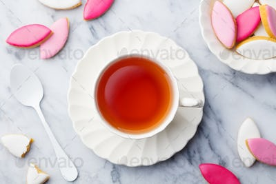 Cup of Tea with Calissons. Traditional French Provence Dessert. Top view. Marble Background.