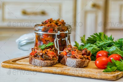 Close up home made aubergine pate or spread sandwiches and in jar