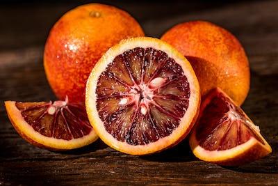 Whole and cut ripe juicy Sicilian Blood oranges