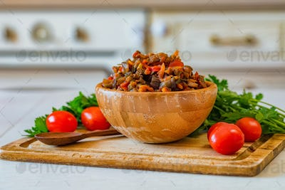 Close up home made aubergine pate or spread in wooden bowl