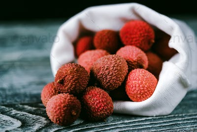 Lychee fruit in white sack close