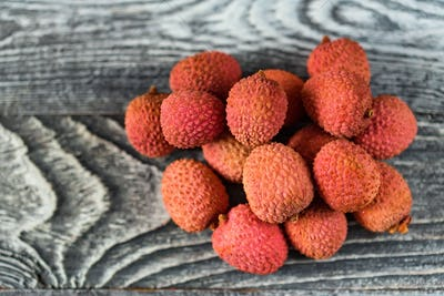Top view lychee fruit on wooden background