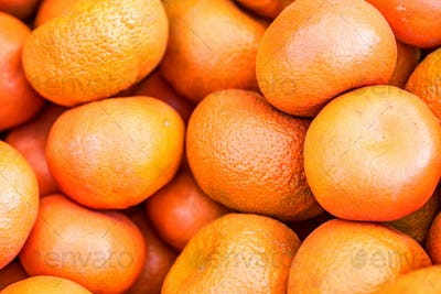 Close up many bright tangerines background