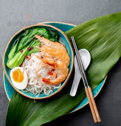 Asian rice noodle with shrimps and pok choy cabbage.