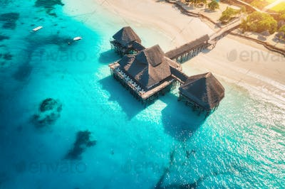 Aerial view of beautiful hotel on the water in ocean at sunset