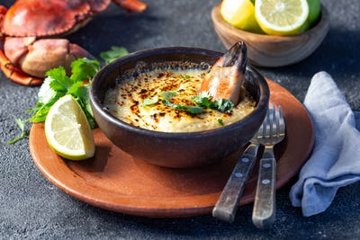 Baked crabmeat crab meat with cheese, cream and bread.