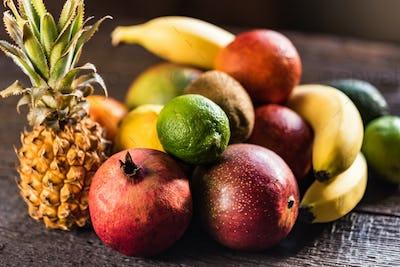 Studio shot of various exotic fruit on wood