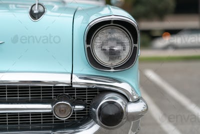 Close up of vintage blue car bumber and lamps