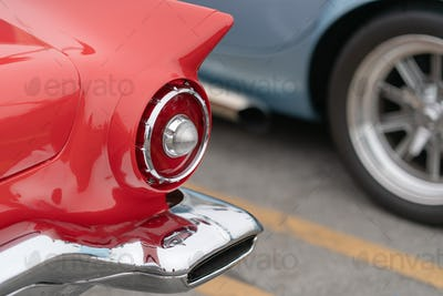 Close up of vintage red car bumper and lamps
