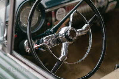 Close up of driver's wheel of vintage car
