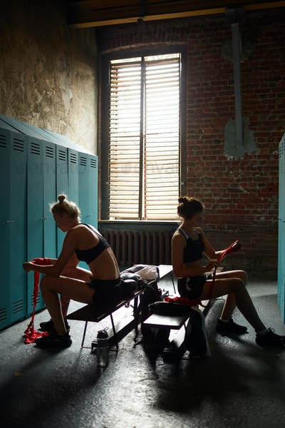Two Female Boxers Preparing for Practice