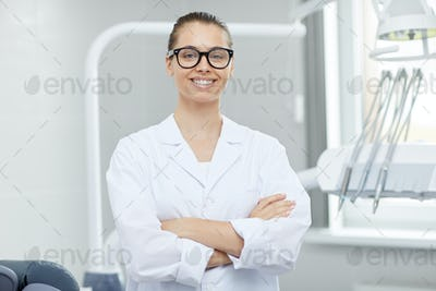 Female Dentist Posing in Office