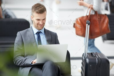 Marketer working with online data in airport