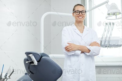 Professional Female Dentist Posing in Office