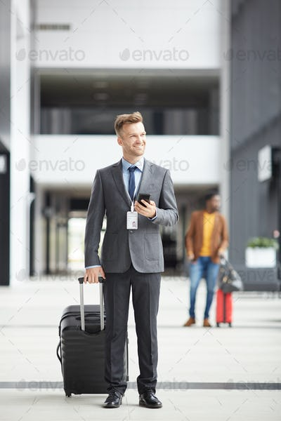 Businessman arriving in airport