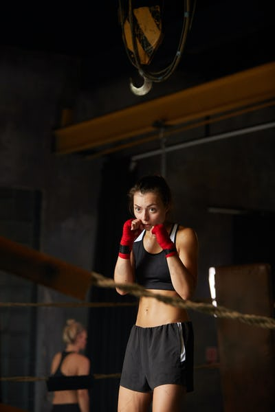 Tough Young Woman Boxing in Ring