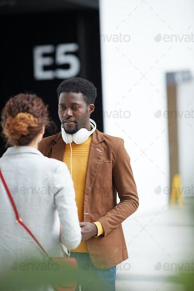Black man asking girl in airport
