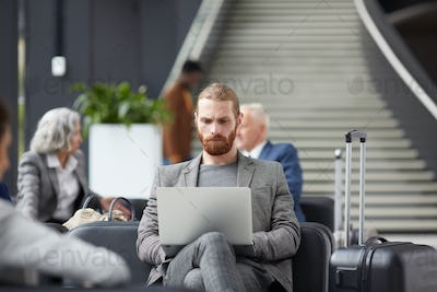 Concentrated guy working in airport
