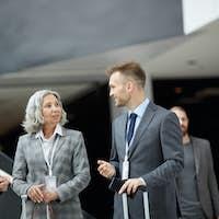 Forum participants with suitcases