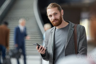 Positive bearded guy with gadget