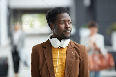Afro-American man walking over airport