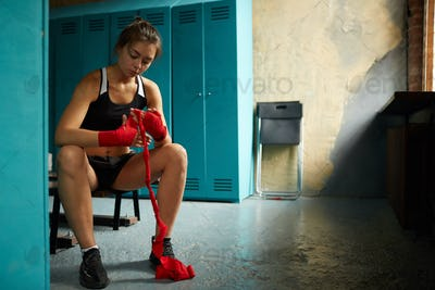 Female Fighter Wrapping Hands