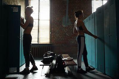 Two Women Dressing in Sports Club