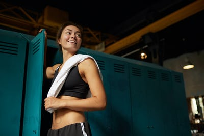 Smiling Woman Dressing in Sports Club