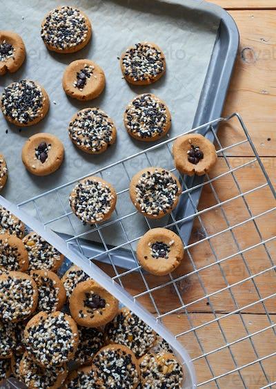 Homemade sesame cookies on table