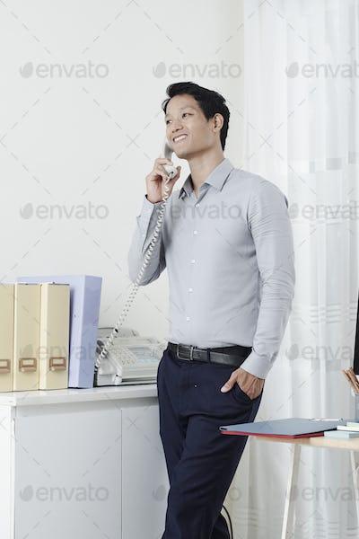 Businessman answering phone call
