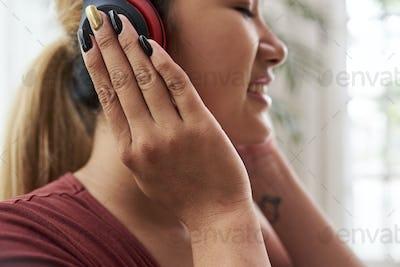 Woman enjoying good music