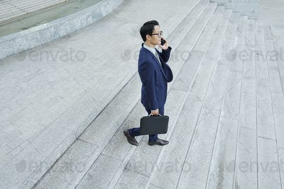Businessman calling his employee
