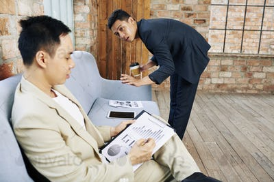 Business people discussing financial reports