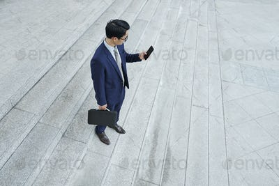 Businessman checking phone